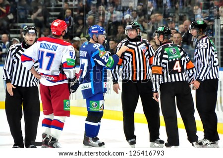 MINSK, BELARUS-SEPTEMBER15:Two captains: Vladimir Denisov(Dynamo) and Alexander Radulov(#47) speak with referees during KHL match Dynamo Minsk VS CSKA Moskow on September 15, 2012 in Minsk, Belarus. - stock photo