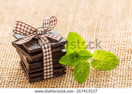 Mint and chocolate nicely served with rustic. - stock photo