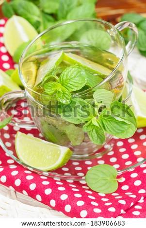 Mint and lime iced green tea.  Macro, selective focus - stock photo