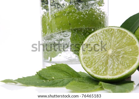 Mint and lime in a glass isolated on white - stock photo