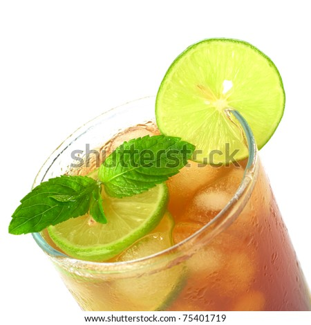 Mint leaf and lime slice on the top of iced tea (Selective Focus, Focus on the mint leaf and the lime slice on the glass rim) - stock photo