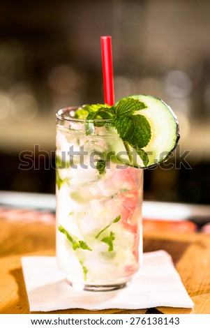 Mint Mojito with garnishes at the bar. - stock photo