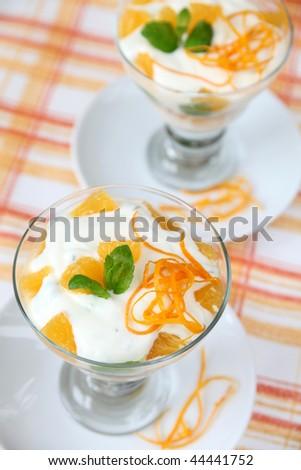 Mint yogurt dessert with oranges - stock photo
