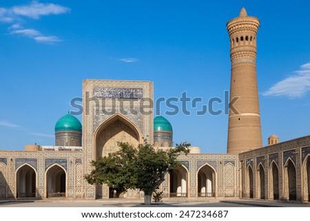 Mir-i Arab Madrasah, Mosque Kalon and Kalyan minaret, Historic center of Bukhara, Uzbekistan (UNESCO World Heritage) - stock photo