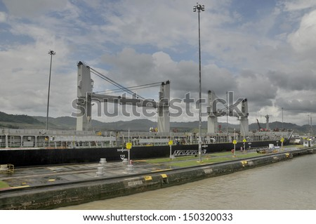 MIRAFLORES LOCKS, PANAMA-CANAL NOV. 7: Miraflores is the name of one of the three locks that form part of the Panama Canal. On nov. 7 2012 in Panama. Ships are raised a total of 87 feet above sea. - stock photo