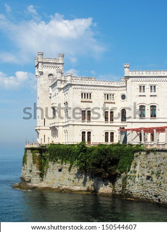 Miramare Castle in Trieste above the Adriatic sea. Italy, EU. It was built in 19th century, castle is famous tourist attraction now. - stock photo