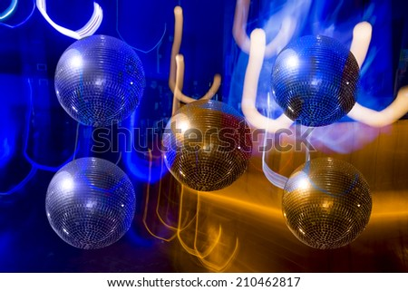 Mirror ball disco on the background-color illumination abstract - stock photo