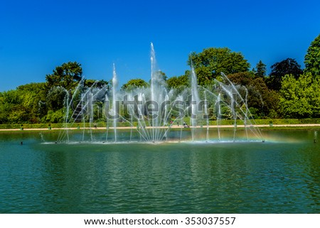 Mirror Fountain (1702) in gardens of famous Versailles palace. Palace of Versailles was a royal chateau. It was added to UNESCO list of World Heritage Sites. Paris, France. - stock photo