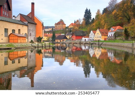 Mirror image of the historical town of Cesky Krumlov reflected by Vltava river , Czech Republic - stock photo