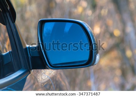 Mirror in a car in the middle of the park - stock photo
