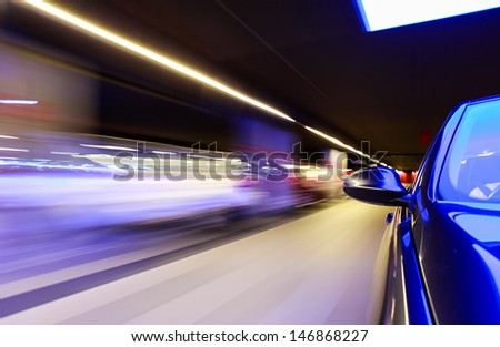 Mirror view at underground car park with heavy blurred motion. - stock photo