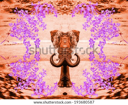 Mirrored elephant spraying water in brilliant colors - stock photo
