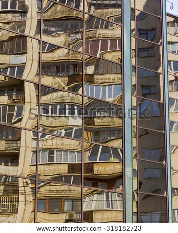 Mirrored wall of a skyscraper with reflection.  - stock photo
