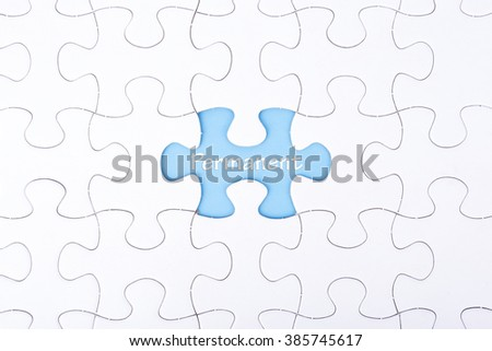 Missing a piece of puzzle in the center, blue space with word PERMANENT, business and financial concept. - stock photo