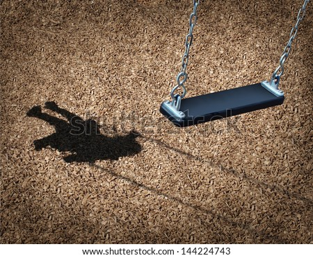 Missing child concept with an empty playground swing and the shadow of a little girl on the park floor as a symbol of children losing their childhood as being lost in a failed adoption or despair. - stock photo