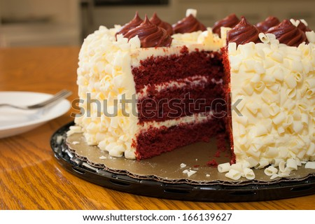 Missing piece of the red velvet cake on the table - stock photo