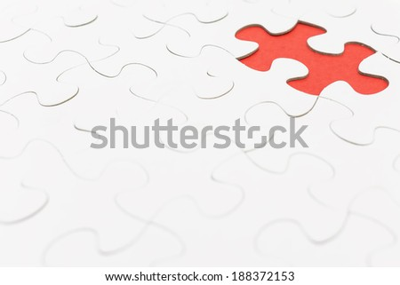 Missing puzzel in red color. Selective focus - stock photo