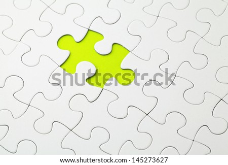 Missing puzzle piece in green color - stock photo