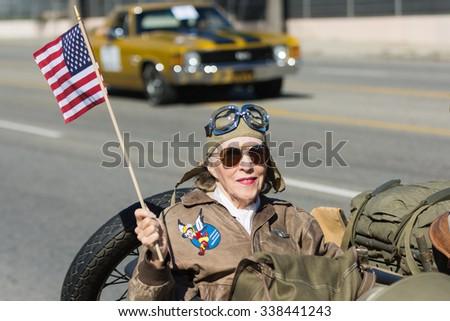 Mission Hills, USA - November 11, 2015: American woman veteran during The San Fernando Valley Veterans Day Parade - stock photo
