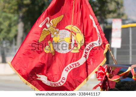 Mission Hills, USA - November 11, 2015: United States Marine Corps flag during The San Fernando Valley Veterans Day Parade - stock photo
