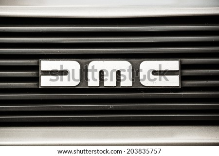 """MISSISSAUGA, CANADA - JULY 7 2014: The front emblem of a DeLorean DMC-12.  As seen at """"Classics on the Square"""", a car show at Celebration Square in Mississauga, Canada on July 6, 2014. - stock photo"""