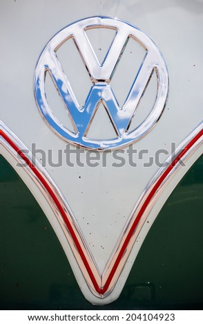 "MISSISSAUGA, CANADA - JULY 6 2014: Volkswagen emblem as seen on the front of the Volkswagen Type 2, also known as a VW Bus. Seen at ""Classics on the Square"", a car show in Mississauga, Canada. - stock photo"
