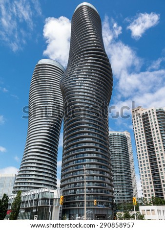 MISSISSAUGA, CANADA - JUNE 24, 2015: Absolute World is a residential condominium twin tower skyscraper complex in the five tower Absolute City Centre development in Mississauga, Ontario, Canada. - stock photo