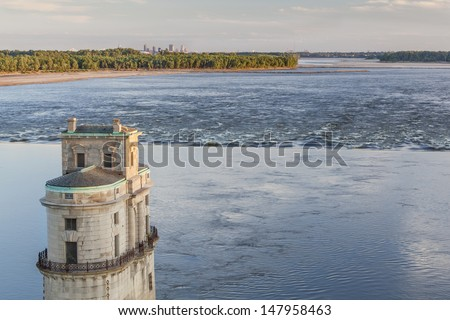 Mississippi RIver at Chain of Rocks with historical water intake tower and distant cityscape of St Louis - stock photo