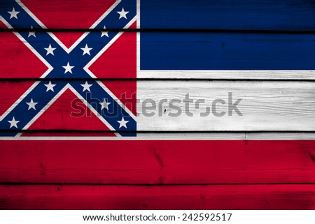 Mississippi State Flag on wood background - stock photo