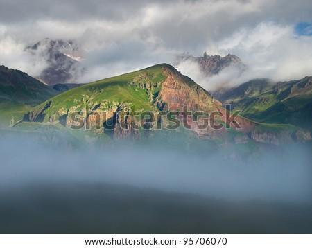 Mist amongst mountain hills. Mountain valley - stock photo