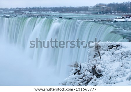 Mist at the Horseshoe Falls, Niagara Winter scene - stock photo