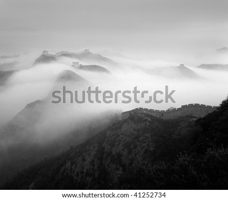 Mist clothed the moutain. Black and white. - stock photo