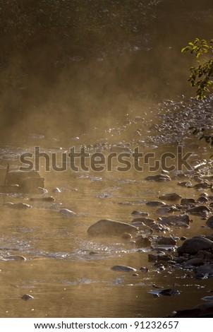 Mist on river Saskatchewan Canada - stock photo