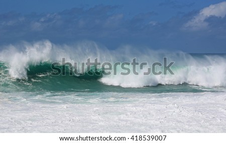 Mist over green wave - North Shore, Oahu, Hawaii - stock photo