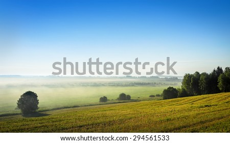 mist over the rural landscape - stock photo
