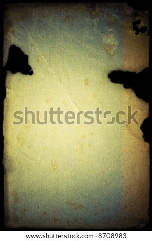 Mist rotting grunge damaged paper with cuts & folds, isolated on black - stock photo