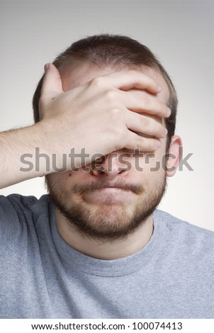 Mistake expression portrait of a young man worrying . - stock photo