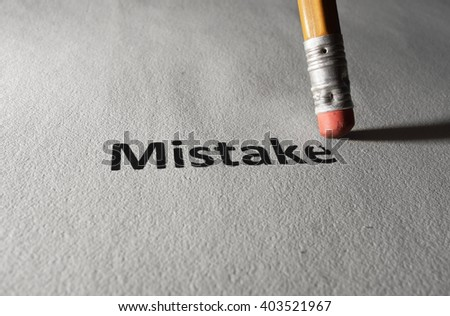 Mistake text on textured paper being erased with a pencil                                - stock photo