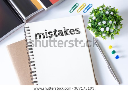 mistakes word message on white paper book and copy space on white desk / business concept / top view - stock photo