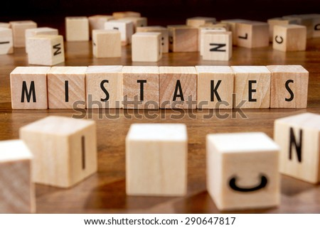 MISTAKES word written on wood block - stock photo