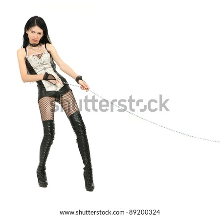 Mistress is holding a chain  isolated on white background - stock photo