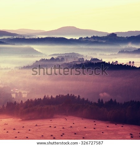 Misty autumn mountain hills landscape. Filtered image with cross processed vivid effect.  - stock photo