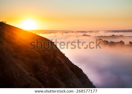 Misty dawn from hill over Valley and the forest  - stock photo