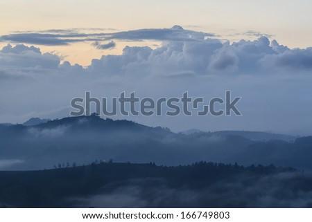 Misty daybreak in autumn Carpathian mountain - stock photo