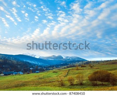 Misty early daybreak in autumn Carpathian mountain, Ukraine (Petros Mount in far) - stock photo