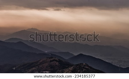 Misty evening over mountains Hong Kong, China - stock photo