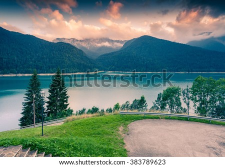 Misty evening scene on the Sauris lake, Friuli-Venezia Giulia location in the italian Alps, Italy, Europe. Green color toning. - stock photo