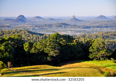 Misty Glasshouse Mountains from Maleny - stock photo