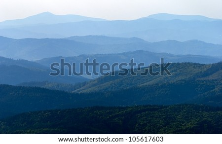 misty horizons blue tones - view from Mala Fatra mountains to Beskyd or beskydy mountains - Karpathos mountains - Europe - stock photo