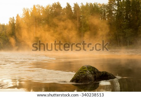 Misty morning at the river in the countryside - stock photo